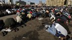 Protesters opposing Egyptian President Mohamed Mursi attend Friday prayers at Tahrir Square 25 January