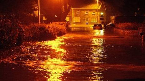 Floodwater on the road in Llanddowror