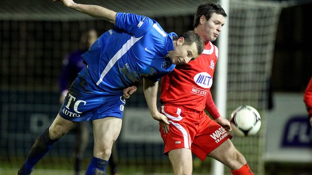 Leon Carters of Ballinamallard in action against Portadown's Kevin Braniff