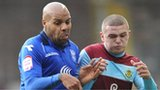 Birmingham City's Marlon King (left) battles for the ball with Burnley's Kieran Trippier (right)