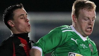 Paul Heatley of Crusaders and Cliftonville&#039;s George McMullan