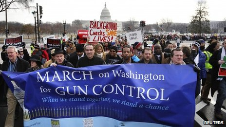 Washington DC Mayor Vincent Gray (4th L) helps lead the March on Washington for Gun Control on the National Mall in Washington, 26 January 2013