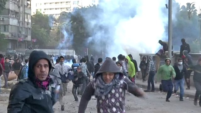 Demonstrators run away from teargas