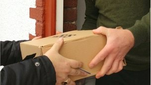 Closed up shot of parcel being handed over on a doorstep