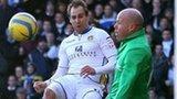 Luke Varney clips the ball past Brad Friedel to put Leeds ahead