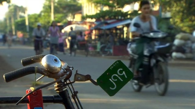 Motorbike and bicycles on a Burmese street