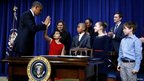 US President Barack Obama unveils gun control plans with children who wrote him letters after December's Newtown shooting