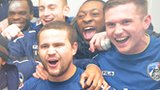 Oldham's players celebrate their win over Liverpool which earned them a tie against Everton