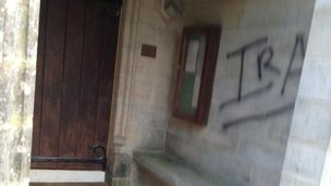 Graffiti on door of church