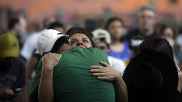 Relatives of victims of the fire at Boate Kiss nightclub, Brazil, attend a wake in the southern city of Santa Maria