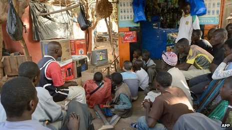 Fans watch football in Mali
