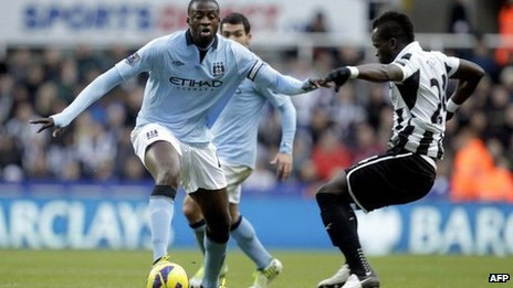 Newcastle United's Ivorian midfielder, Cheick Tiote (R) vies with Manchester City's Ivorian midfielder, Yaya Toure (L) during an English FA Premier League football match at St James Park, Newcastle upon Tyne, England, on December 15, 2012.
