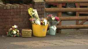 Floral tributes at the scene of the incident