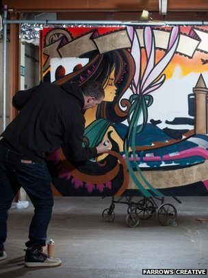 Inkie at work on his piece 'Bristol to Brooklyn'