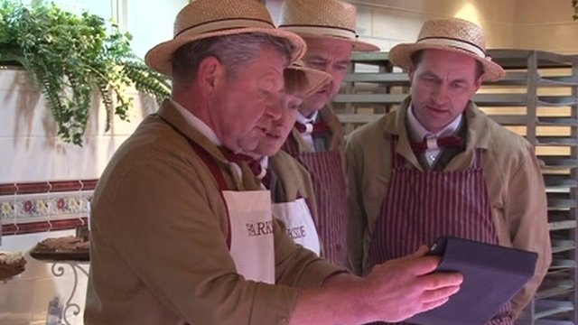 Staff at a farm shop take a look at the proposed HS2 route