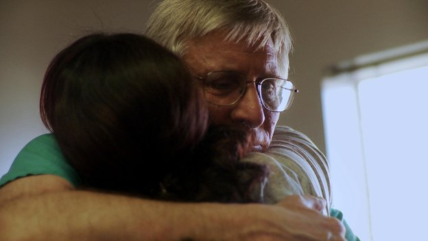 Dr Hern hugs a patient