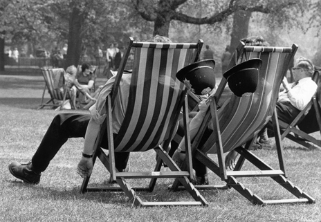Two beat officers rest in deckchairs, 1976