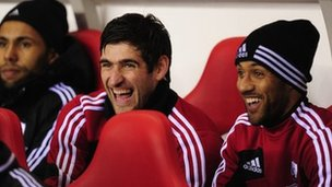 Swansea striker Danny Graham jokes with Wayne Routledge (right)