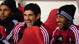 Swansea striker Danny Graham jokes with Wayne Routledge (right)