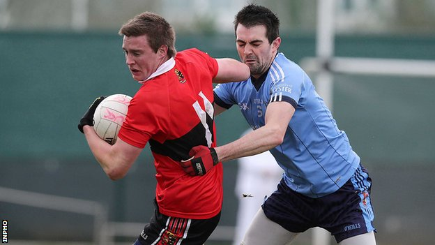 UUJ's Gerard McCartan tries to get a challenge in on UCC's Brian Coughlan