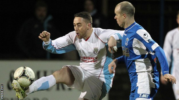 Shane Dolan of Ballymena in action against Dungannon's Adam McMinn