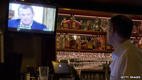 Man watches Lance Armstrong's Oprah interview in a bar