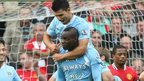 Mario Balotelli with team mate Sergio Aguero