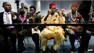 Nigerian farmers (L to R) Alali Efanga, Friday Alfred Akpan-Ikot Ada Udo, Chief Fidelis A Oguru and Oruma en Eric Dooh sit in court on 11 October 2012 as part of their proceedings against oil firm Shell