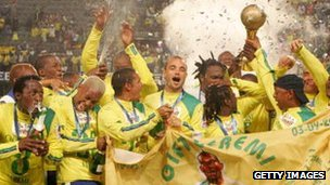 The Mamelodi Sundowns players pose with the Trophy after winning the final during the SAA Supa 8 Final match between the Mamelodi Sundowns and the Orlando Pirates at the Absa Stadium in September 2007 in Durban, South Africa