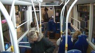 Passengers boarding a Jersey bus