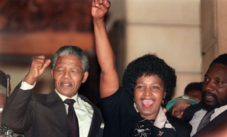 Nelson Mandela and his then wife raise their fists in celebration as he left prison