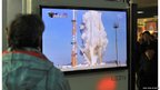 South Koreans watch live footage of South Korea's third attempt of a rocket launch