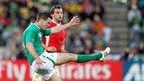 Ireland fly-half Jonathan Sexton kicks under pressure from Wales captain Sam Warburton