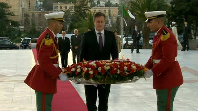 David Cameron lays a wreath as a mark of respect to the hostages who died in the In Amenas siege