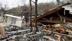 Residents search through debris in Coble, Tennessee. Photo: 30 January 2013
