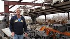 A man stands in front of a destroyed newspaper distribution centre in Mount Juliet, Tennessee. Photo: 30 January 2013