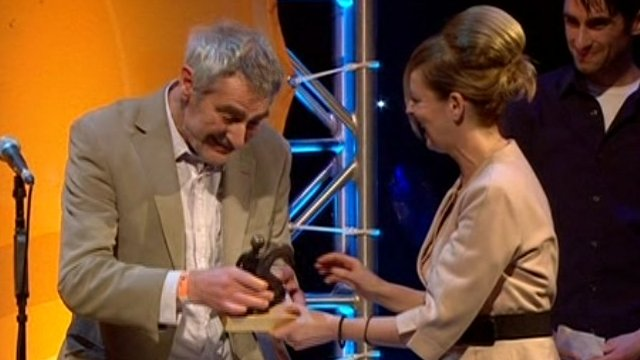 Nic Jones accepting his award from Clare Grogan