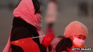Beijing residents mask their faces against the smog on 30 January 2013