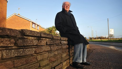 Harry Francis sitting at the spot where he and his family were brought to safety