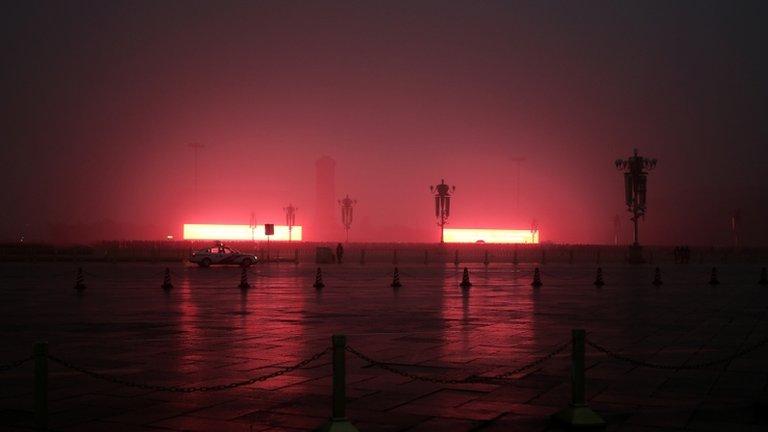 Flag-raising ceremony on Beijing's Tiananmen Square during severe pollution