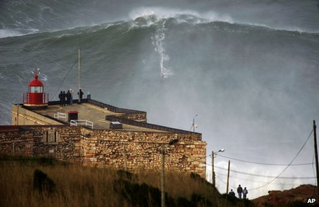 Big-wave surfer Garrett McNamara drops in on a large wave at Praia do Norte in Nazare, Portugal, 28 January