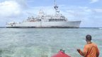 A member of the Philippine Coast Guard approaches the USS Guardian - January 24