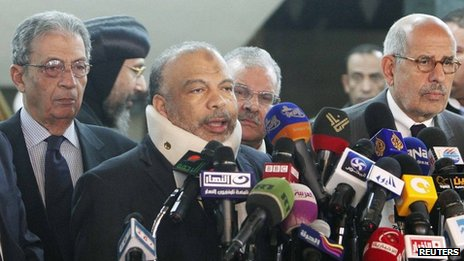 Saad al-Katatni, head of the Egyptian Muslim Brotherhood's Freedom and Justice party, talks during a news conference next to former Egyptian foreign minister Amr Moussa (L) and Egyptian liberal politician Mohamed ElBaradei (R)