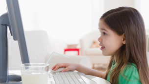 Child using desktop computer