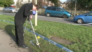 Forensic teams examine the scene near the University campus