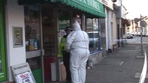 Police at the shop in Cathays