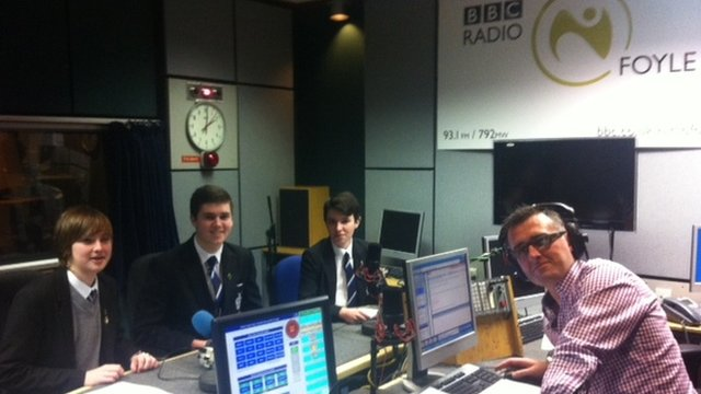 Garry (left), Jack (centre) and Kane (right) from St Columb&#039;s College with BBC Radio Foyle presenter Mark Patterson