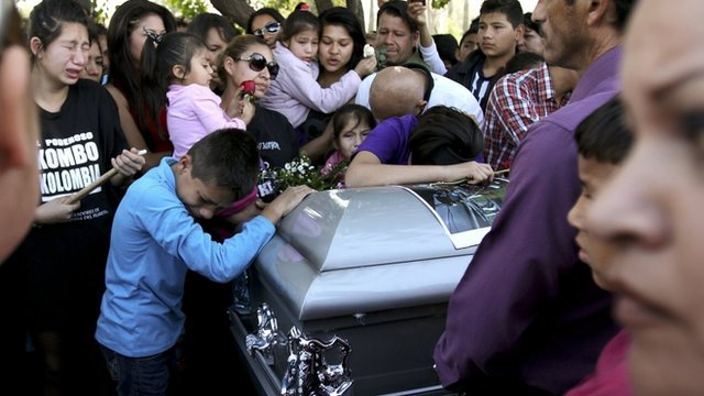 Mourners at band member's funeral