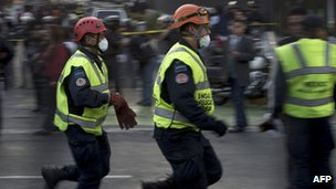 Rescue workers rush to the damaged Pemex building in Mexico City (1 February 2013)