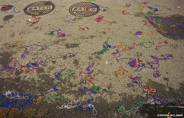 Beads thrown from floats on the ground
